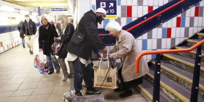 man helping elderly woman