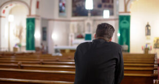 Man in church praying
