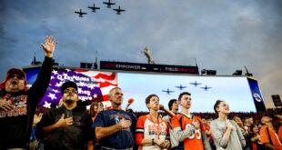 Family of Southern rednecks singing the anthem