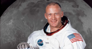Buzz Aldrin in front of moon