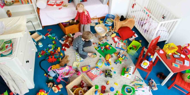 room with toys and 2 kids