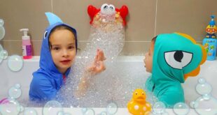 kids in a bath with toys