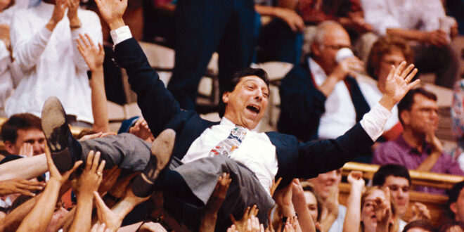 Jim Valvano being carried off the court after winning