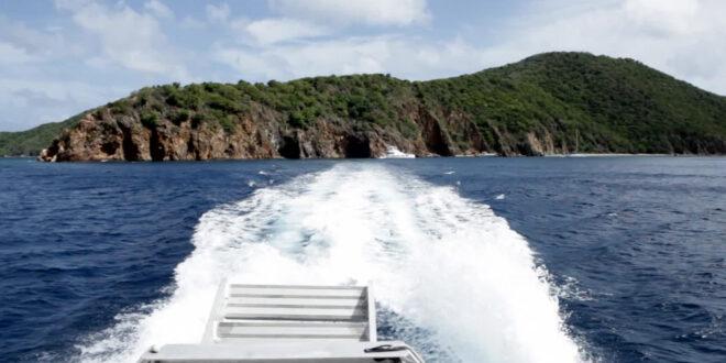 wake of boat leaving large island