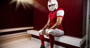 Football player sitting in locker room