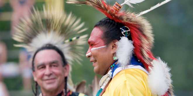 2 Indian Chiefs smiling