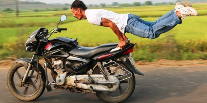 man flying behind motorcycle