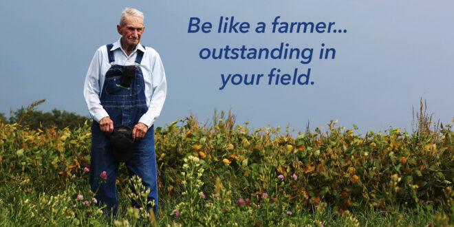 old farmer in field of wildflowers