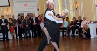 elderly couple doing ballroom dancing