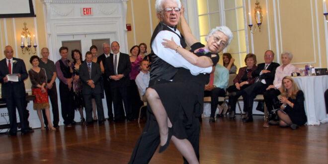 elderly couple doing ballroom dancing