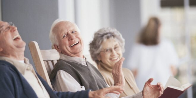 Elderly people laughing at funny stories