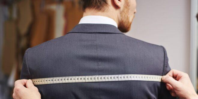 Man gets measured for a jacket