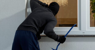 burglar at house window