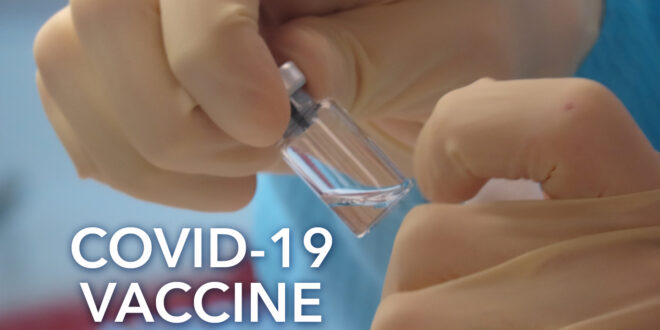 Vile in lab with text Covid-19 Vaccine