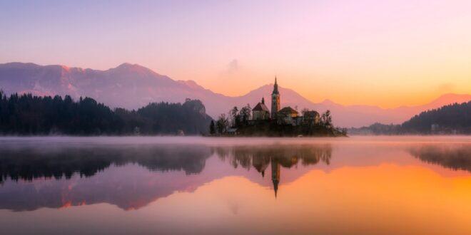sunrise over lake and church