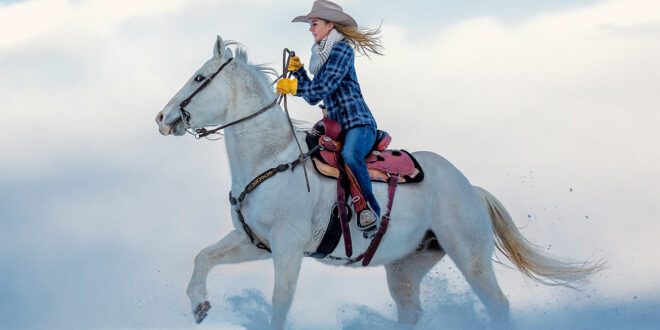 Blond Cowgirl riding horse