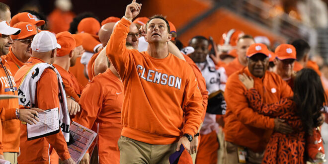 Dabo Swinney pointing to Heaven