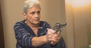 elderly lady with a hand gun