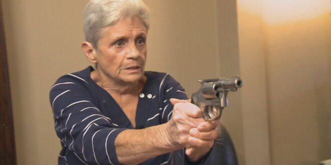 elderly lady with a hand gun