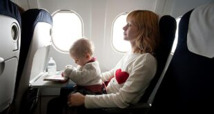 Mother and her baby at the window seat of an airplane