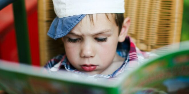Boy reading funny stories