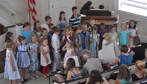 children singing in church