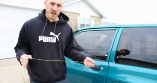 man uses coat hanger to open locked car