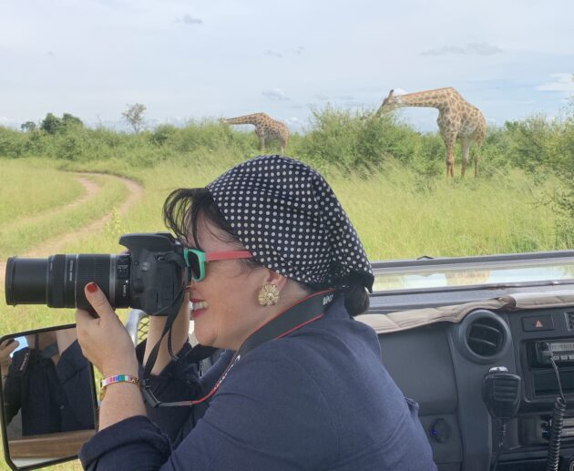 Katrina Holden photographing girafes on safari in Chobe National Park Botswana