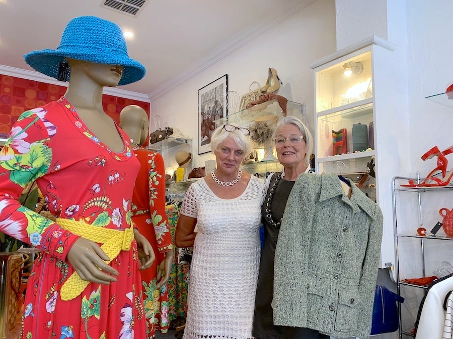 L-R: Gillian and Meera (holding a Burberry suit) at Twisting Vintage in Mittagong. Image: Vintage Travel Kat