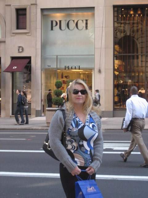 Martha Hayden Woods In front of the Pucci store in New York wearing a shirt with matching shrug in the Rosone