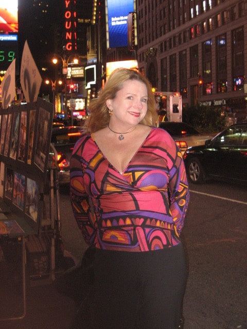 Martha Hayden Woods Times Square New York wearing a Pucci shirt in the Duomo print for the 60th Anniversary of Emilio Pucci designed by Matthew Williamson for Pucci 2007