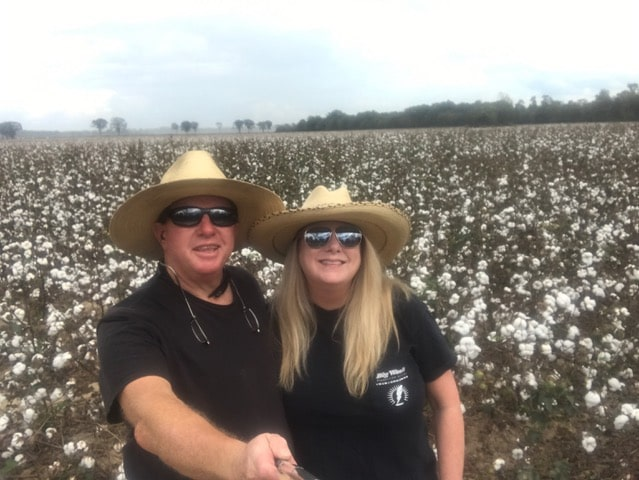 Martha Hayden Woods with husband Harold in a cotton field