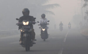 Motorcycle Riders riding in Asian Haze