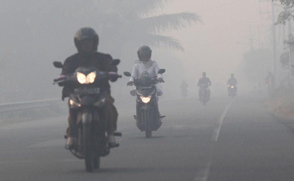 Motorcycle Riders in Bad Air