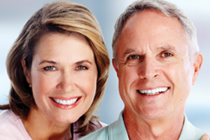 Man and woman with healthy, white smiles
