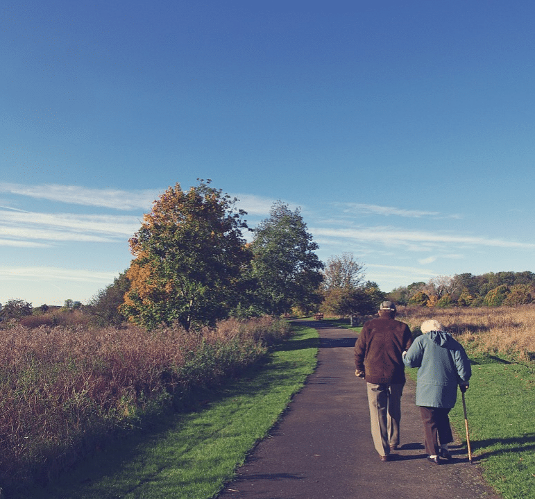 An older couple walking in nature