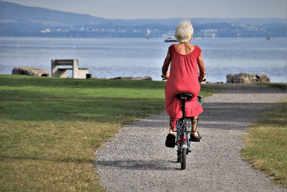 Senior woman cycling in a park