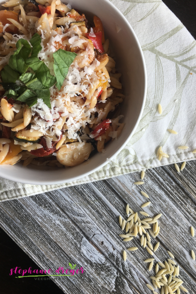 This Roasted Vegetable Orzo is a sophisticated take on the traditional Italian pasta salads I grew up with. Fresh, organic vegetables (in this case, zucchini, bell peppers and cherry tomatoes) are the key to this simple yet savory dish.