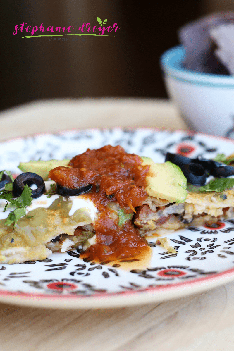 These Black Bean and Potato Enchiladas are Mexican comfort food. Batch cook the potatoes in advance for an easy weeknight meal.