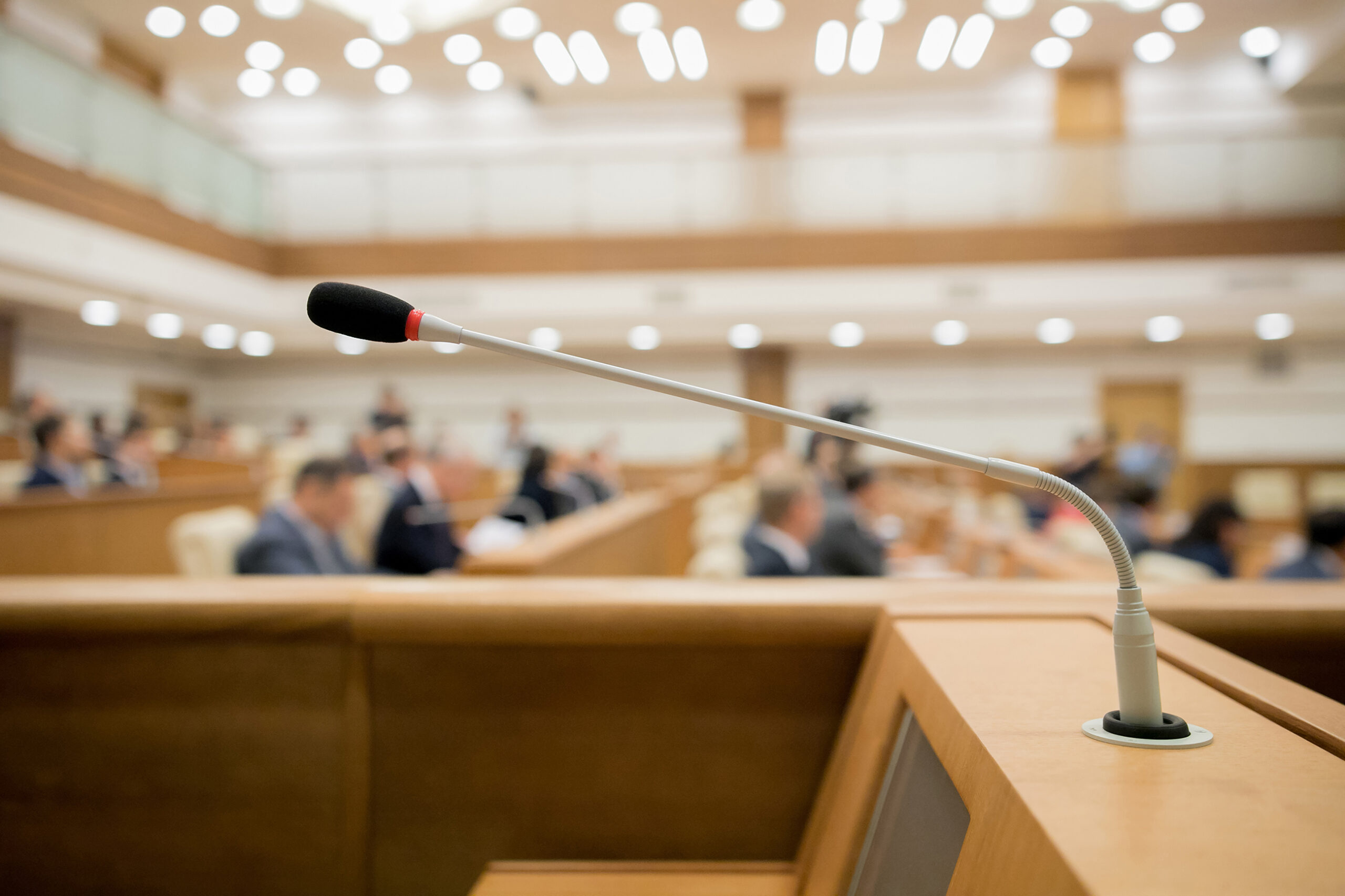 Session of Government. Conference room or seminar meeting room in business event. Academic classroom training course in lecture hall. blurred businessmen talking. modern bright office indoor