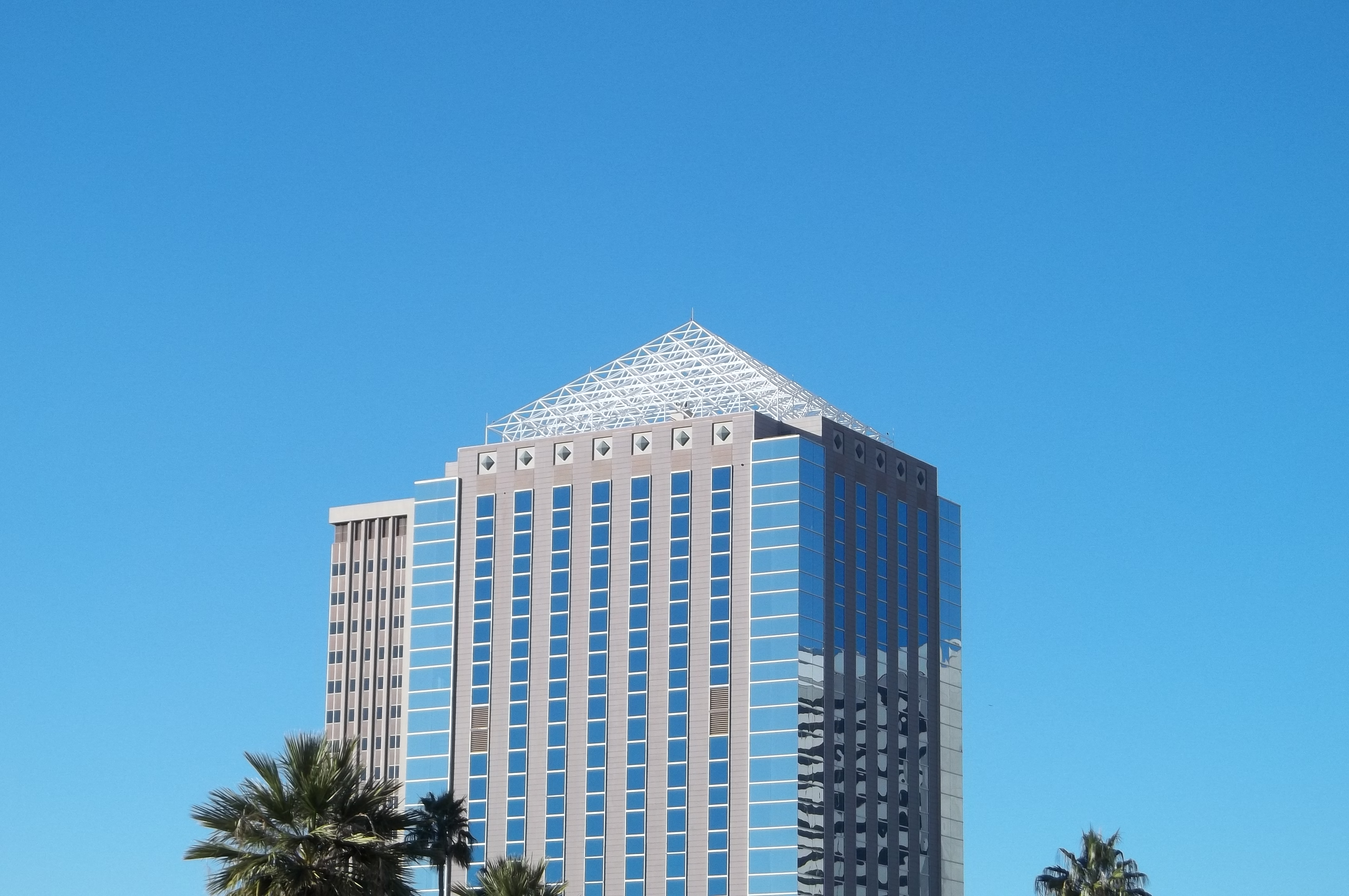 Skeletonized white pyramid atop an office building in downtown Phoenix