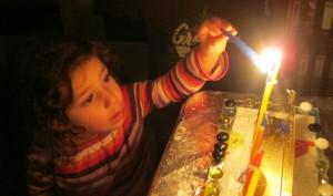 M lighting menorah