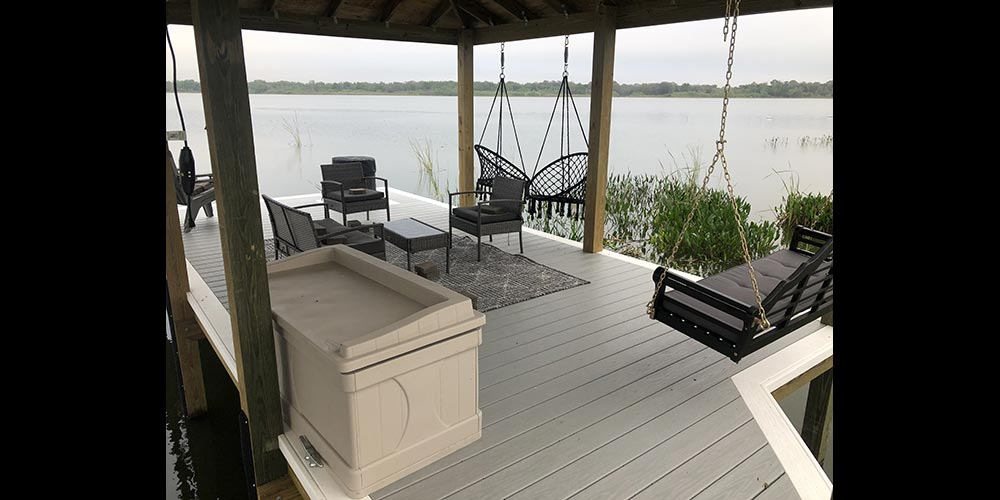 photo of dock with arbor, seating, storage, and swings