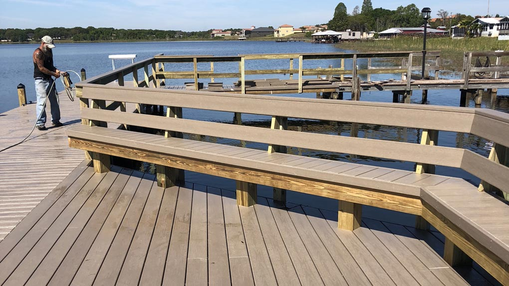 Photo of dock with wood railing and wood seating