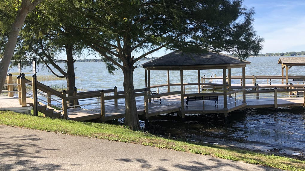 Photo of deck to stairway to dock with arbors