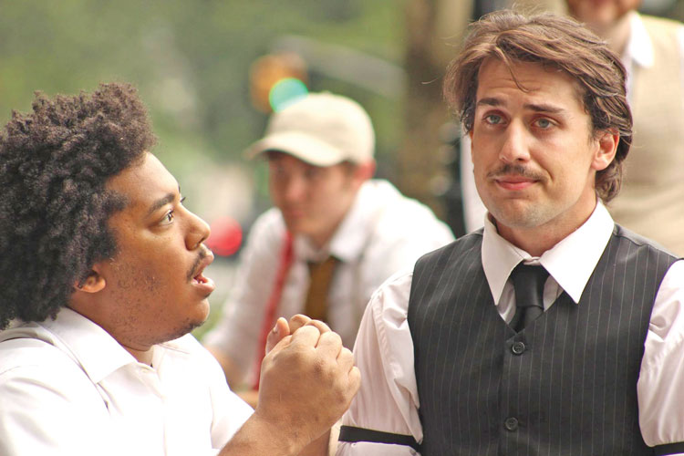 """A scene from """"Two Gentlemen of Verona"""" featuring Anthony Vaughn Merchant and Chris Dooly."""