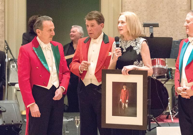 Middleburg Hunt Master Jeff Blue, Hugh Robards, and Middleburg Hunt Master Penny Denegre presenting photo.