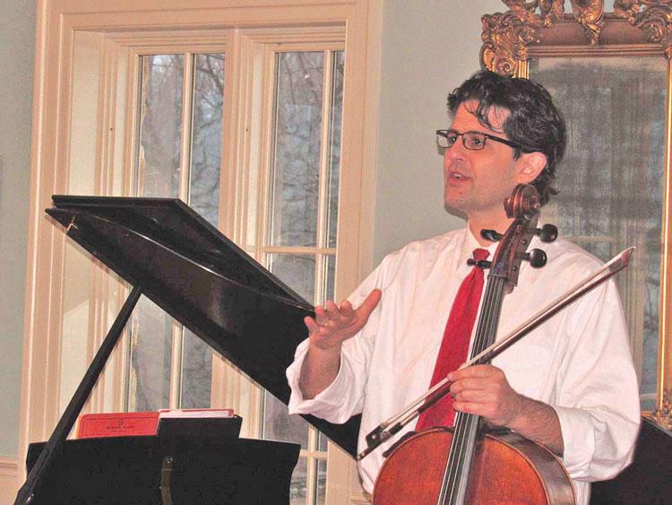 Cellist Amit Peled talks to the audience.