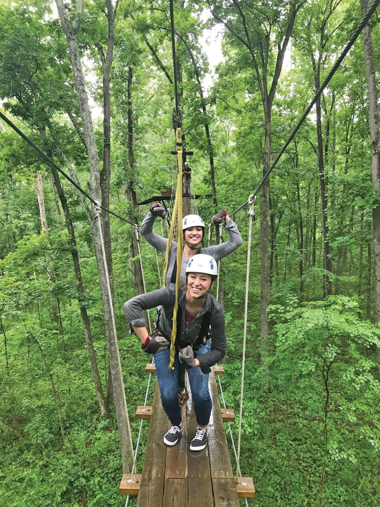 Posing on one the suspension bridges on the Empower Adventures course.