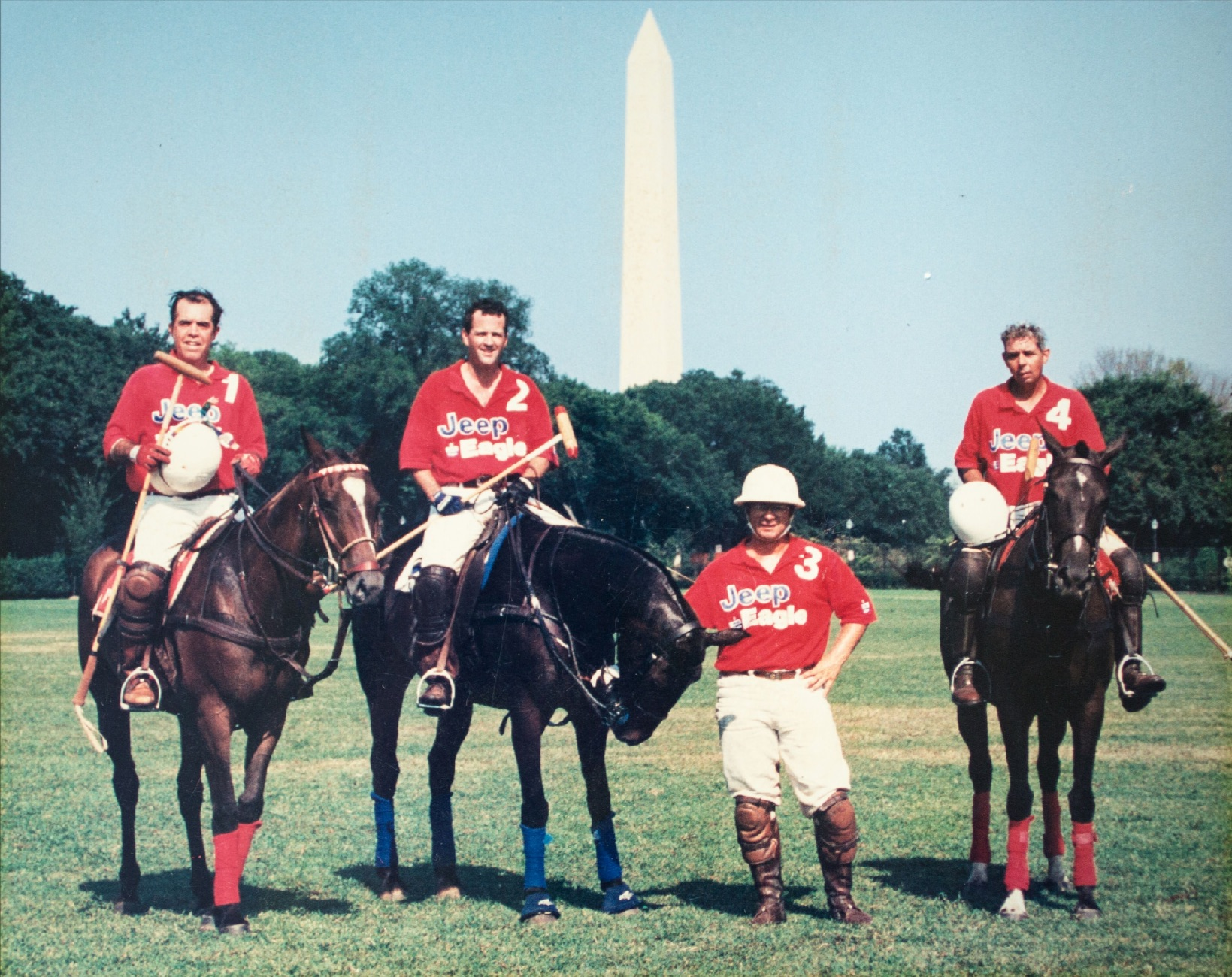 Before the polo fields in The Plains, Great Meadow Polo Club's home field was the National Mall. Club president Dick Vargé, founder Peter Arundel, a pro, and member Tom Leonard pose for a photo in the 1998 season. Courtesy of Peter Arundel.